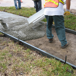 Concrete sidewalk pour using Poly Form Flatwork forms