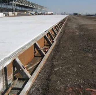 Metal Forms expanded the taxiway with professional concrete forming and finishing.